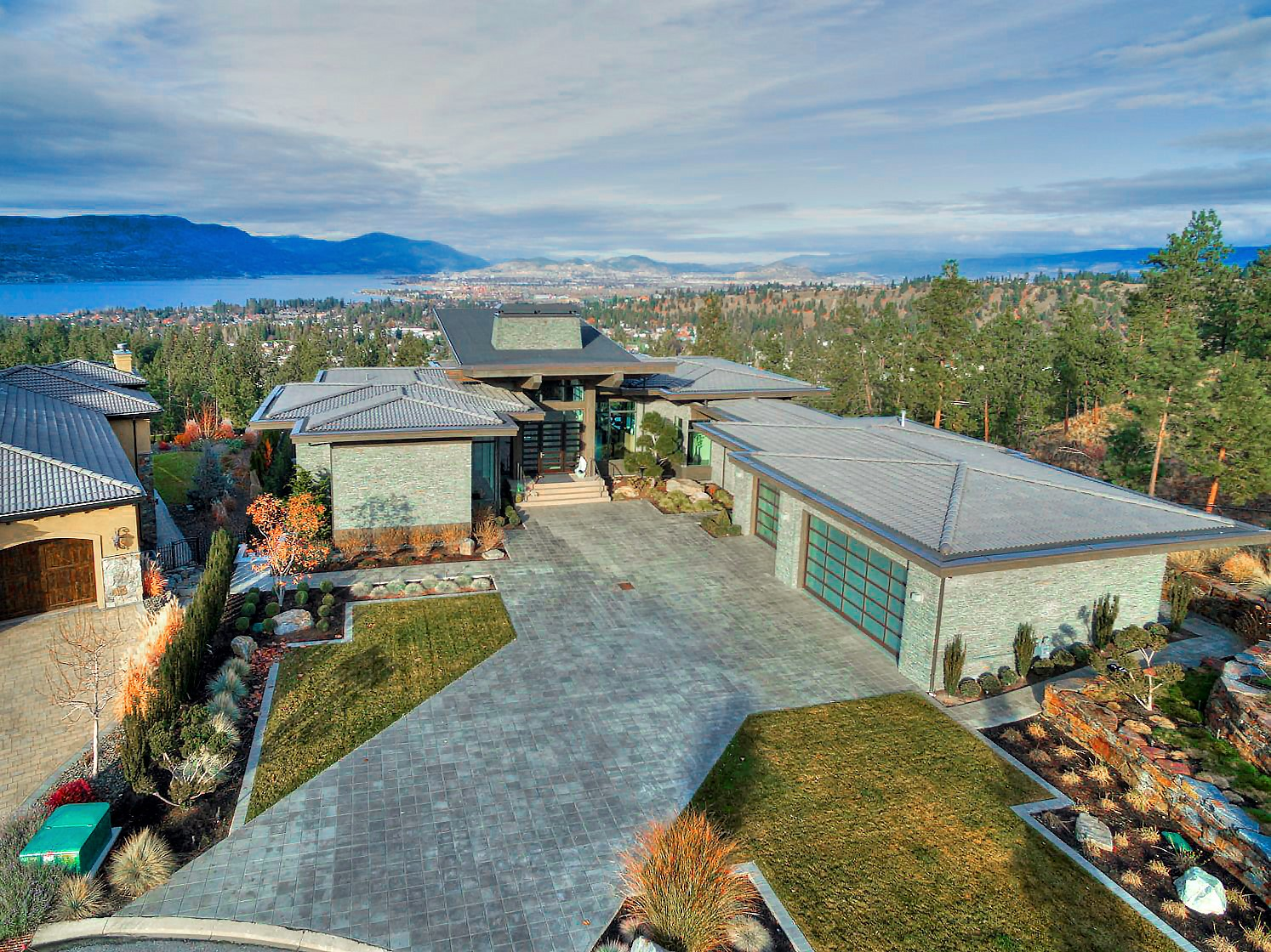 View over Kelowna and Okanagan Lake from modern luxury home